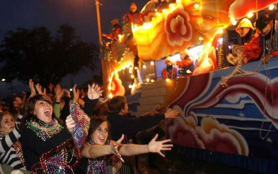 New Orleans: Adriana Gomez of Pensacola, Fla., left, screams as she catches a huge bag of beads with friend Rachel Chapman as they watch the 2,430 riders of the Krewe of Endymion turn off Orleans Avenue onto Carrollton Avenue with a parade entitled Tale of Sleep and Dreams on Saturday, Feb. 21, 2009, in New Orleans. Photo: MICHAEL DeMOCKER, The Times-Picayune