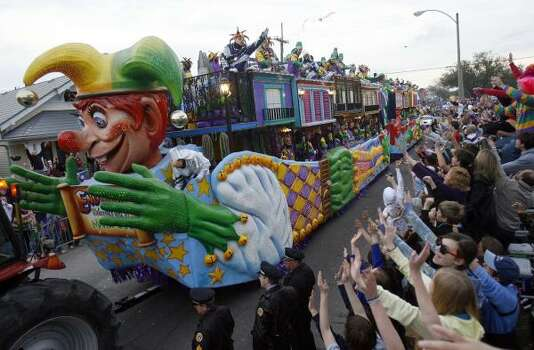 Maskers on the giant jester float shower the crowd with beads as the 2,430 riders of the Krewe of Endymion roll down Orleans Avenue in New Orleans on Saturday, Feb. 21, 2009. Photo: MICHAEL DeMOCKER, The Times-Picayune