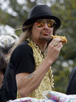 Musician Kid Rock eats some fried chicken on his float before the Krewe of Endymion parade in New Orleans on Saturday, Feb. 21, 2009. Photo: Alex Brandon, AP