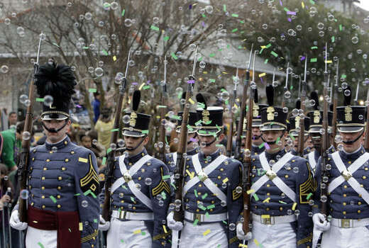 The Citadel Summerall Guards march through the bubbles and confetti during the Krewe of Endymion parade in New Orleans on Saturday, Feb. 21, 2009. Photo: Alex Brandon, AP