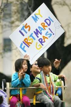 Hoping to catch some extra beads, a sign is held up high at the Iris parade in New Orleans on Saturday, Feb. 21, 2009. Photo: CHRIS GRANGER, The Times-Picayune
