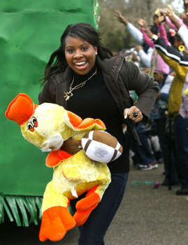 Meghan Thomas of Slidell, La., runs up Holiday Drive after catching a stuffed toy during the NOMTOC (New Orleans Most Talked of Club) parade in Algiers on Saturday, Feb. 21, 2009. Photo: SUSAN POAG, The Times-Picayune
