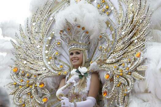 The queen of Endymion waves her scepter during the Krewe of Endymion parade in New Orleans on Saturday, Feb. 21, 2009. Photo: Alex Brandon, AP