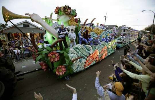 Parade-goers yell for beads and other trinkets during the Krewe of Endymion parade in New Orleans on Saturday, Feb. 21, 2009. Photo: Alex Brandon, AP