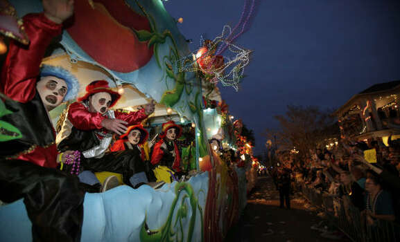 Riders throw beads and other trinkets during the Krewe of Endymion parade in New Orleans on Saturday, Feb. 21, 2009. Photo: Alex Brandon, AP