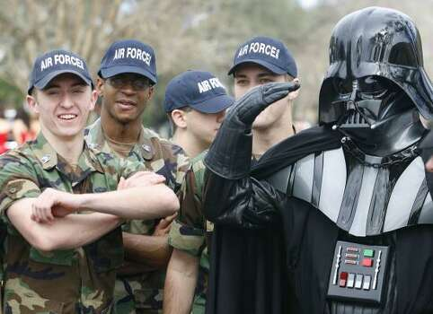 Dressed as Darth Vader, Jack Lockwood of Destrehan, La., salutes members of the Mississippi State University ROTC as they wait for the start of the Tucks parade on Saturday, Feb. 21, 2009, in New Orleans. Photo: CHRIS GRANGER, The Times-Picayune