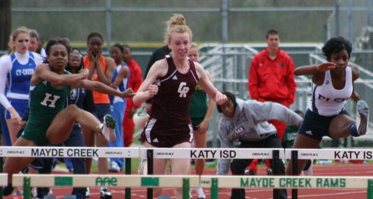 Elsik's Alicia Perkins (right) and Hightower's Chelsea Stephens (left) have a step up on Cinco Ranch's Allyson Pettit (center) in the 110-meter hurdles.