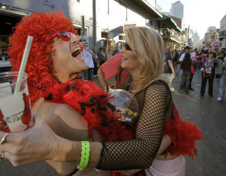 NEW ORLEANS Two revelers embrace on Bourbon Street in the French Quarter Friday, Feb. 20, 2009. Photo: Alex Brandon, AP