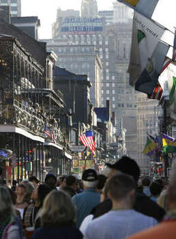People fill Bourbon Street in the French Quarter. Carnival revelers were greeted with good weather for the weekend before Mardi Gras Feb. 24. Photo: Alex Brandon, AP