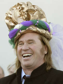 Actor Val Kilmer, who will reign as this year's king of the Krewe of Bacchus, laughs as he receives his new crown during a visit to Children's Hospital in New Orleans. Photo: Alex Brandon, AP