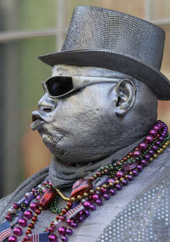"""A reveler who gave his name only as """"Automatic, The Silver Robot,"""" does his act on Bourbon Street. Photo: Alex Brandon, AP"""