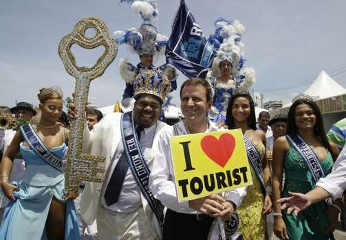 RIO DE JANEIROThe Rei Momo, or Carnival King, second left, holds the key to the city as Rio de Janeiro's Mayor Eduardo Paes holds a sign after a ceremony marking the official start of carnival celebrations Friday. Photo: Silvia Izquierdo, AP