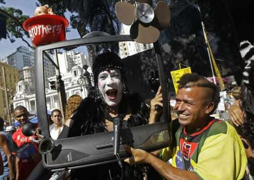 Revelers take part in the Cordao da Bola Preta club street carnival parade in downtown Rio de Janeiro. Photo: Silvia Izquierdo, AP