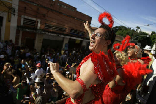 Parties occur each weekend for three weeks leading up to Carnival, but began rolling nonstop Friday afternoon. Photo: Natacha Pisarenko, AP