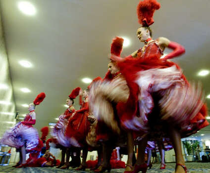 France's Moulin Rouge dancers perform for the press on Feb. 20, 2009, in Rio de Janeiro, Brazil. The troupe will take part in the Grande Rio samba school parade on Feb. 22, paying tribute to France. Photo: ANTONIO SCORZA, AFP/Getty Images