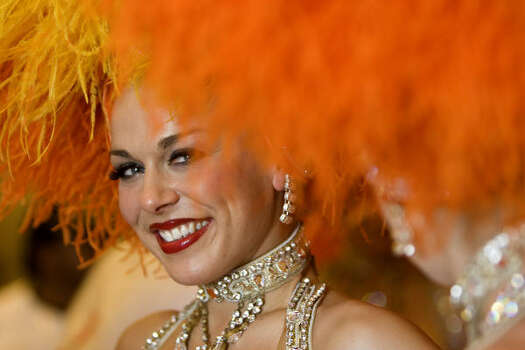 A Moulin Rouge dancer poses after a press conference on Feb. 20, 2009, in Rio de Janeiro, Brazil. Photo: ANTONIO SCORZA, AFP/Getty Images