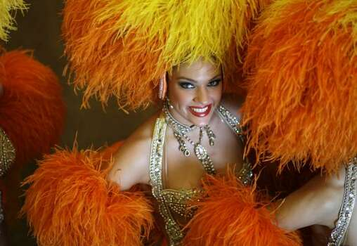 A dancer of France's Moulin Rouge poses for a photo after a press conference in Rio de Janeiro, on Friday, Feb. 20, 2009. Photo: Natacha Pisarenko, AP