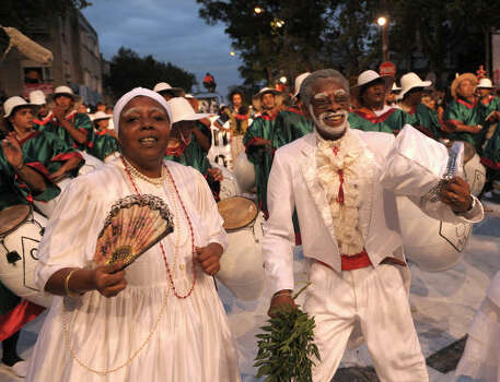 Mama Vieja, left, El Gramillero and drummers perform during the first day of the Llamadas. Photo: MIGUEL ROJO, AFP/Getty Images