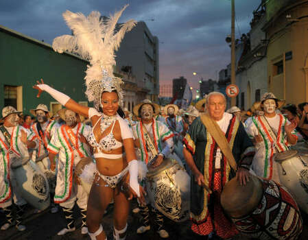 Uruguayan artist Carlos Paez Vilaro, second from right, a dancer and drummers perform during the first day of the Llamadas. Photo: MIGUEL ROJO, AFP/Getty Images