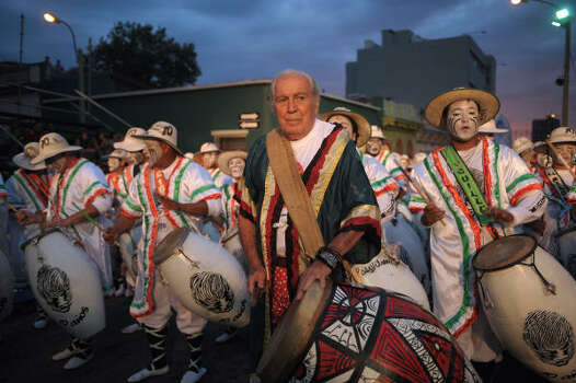 Uruguayan artist Carlos Paez Vilaro, second from right, and drummers perform during the first day of the Llamadas. Photo: MIGUEL ROJO, AFP/Getty Images