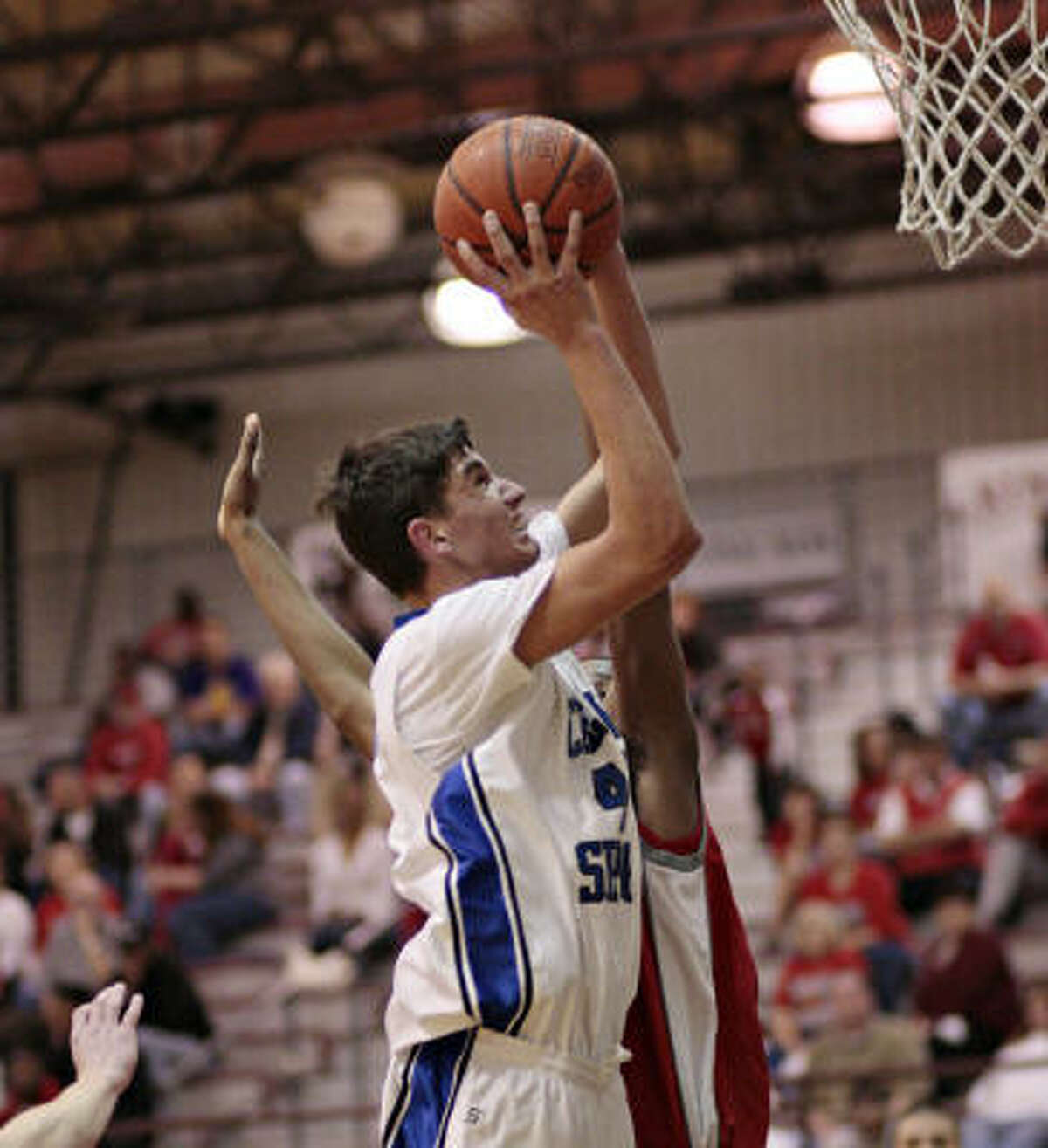 Clear Springs' Ryan Garcia drives strong to the basket during Monday's Region III-5A bi-district round playoff game against Travis, which claimed a 62-48 win.