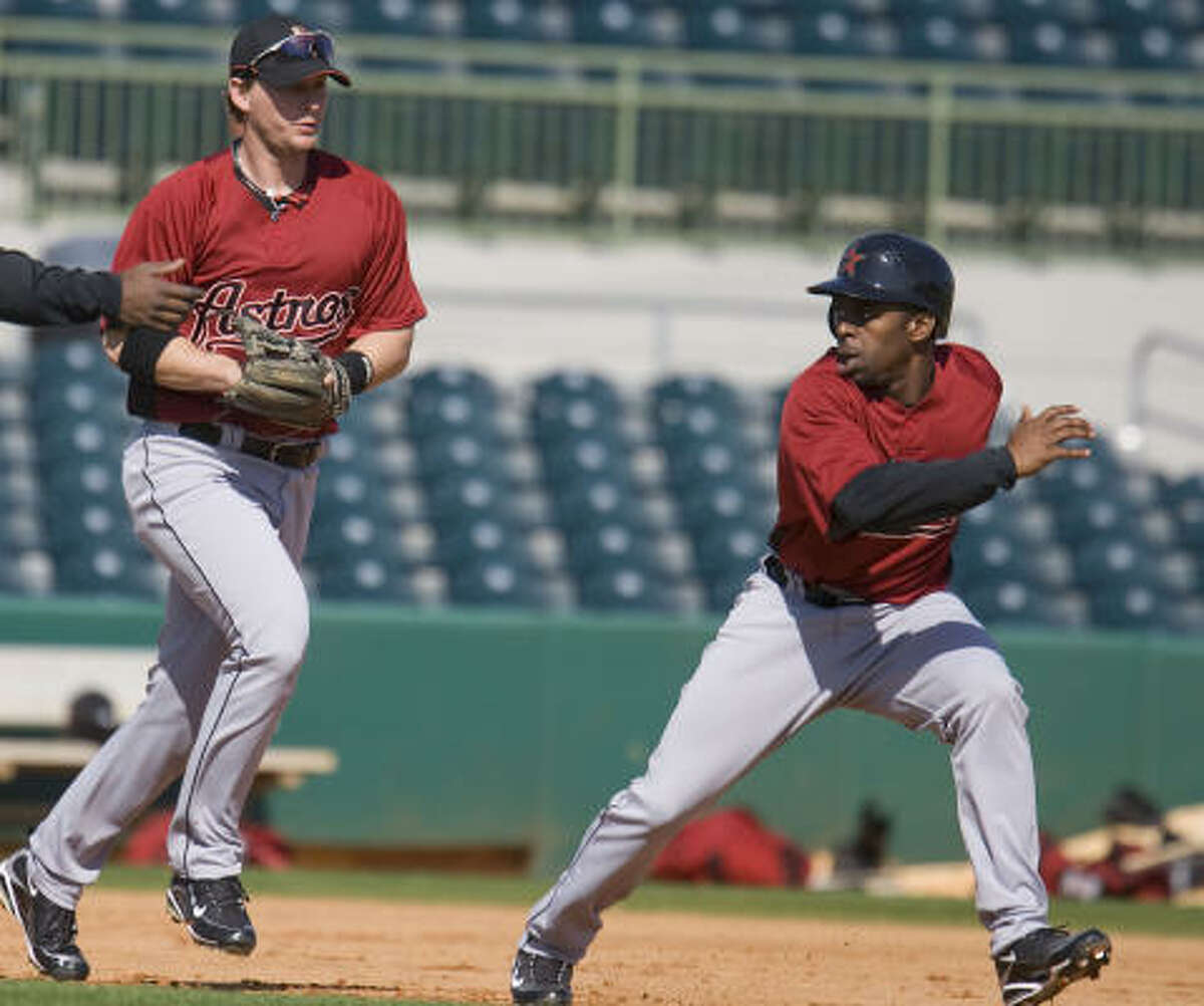Chris Johnson left chases Michael Bourn (right) in a drill.