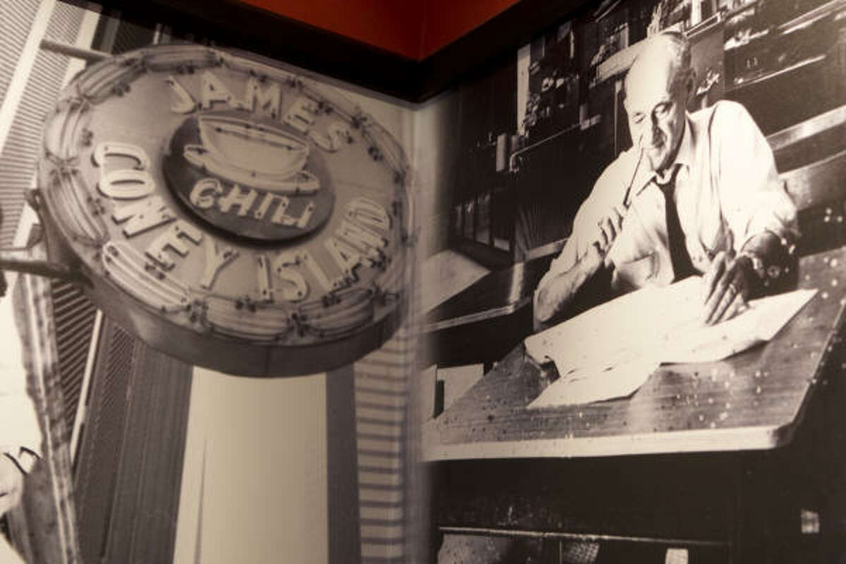 Vintage photos from the original James Coney Island on Walker are shown on the walls of the newest location on West Clay Road.