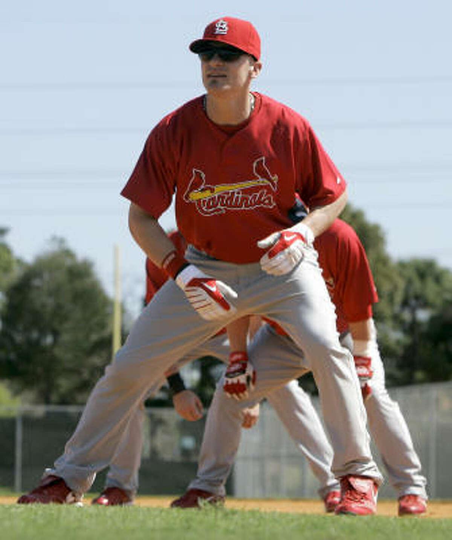 St. Louis Cardinals' Brendan Ryan takes part in base stealing drills during spring training baseball.
