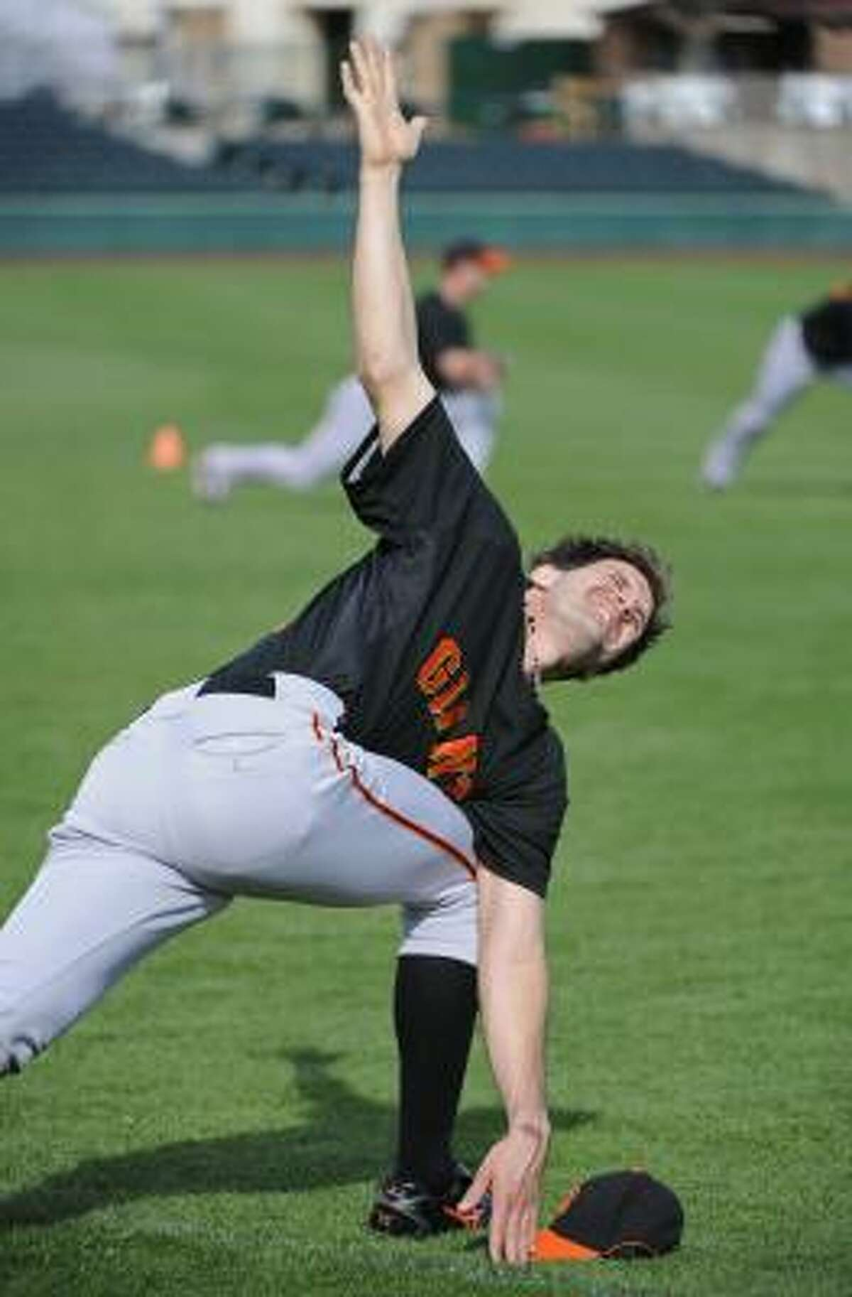 San Francisco Giants pitcher Barry Zito stretches during baseball spring training.