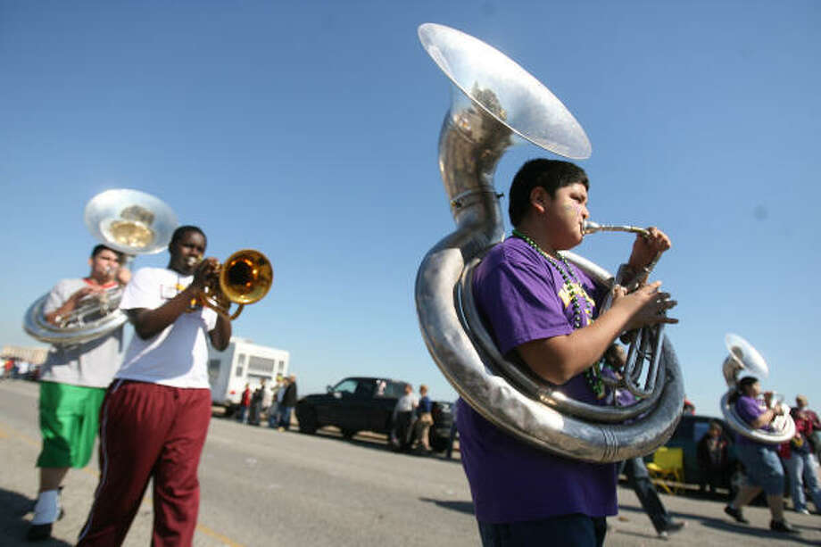 Members of the Ball High School Marching Band entertain spectators. Photo: Mayra Beltran, Chronicle