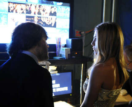 Jack Black, left, and Jennifer Aniston are seen backstage watching the monitors as they wait to go on stage at the 81st Academy Awards. Photo: Chris Carlson, AP