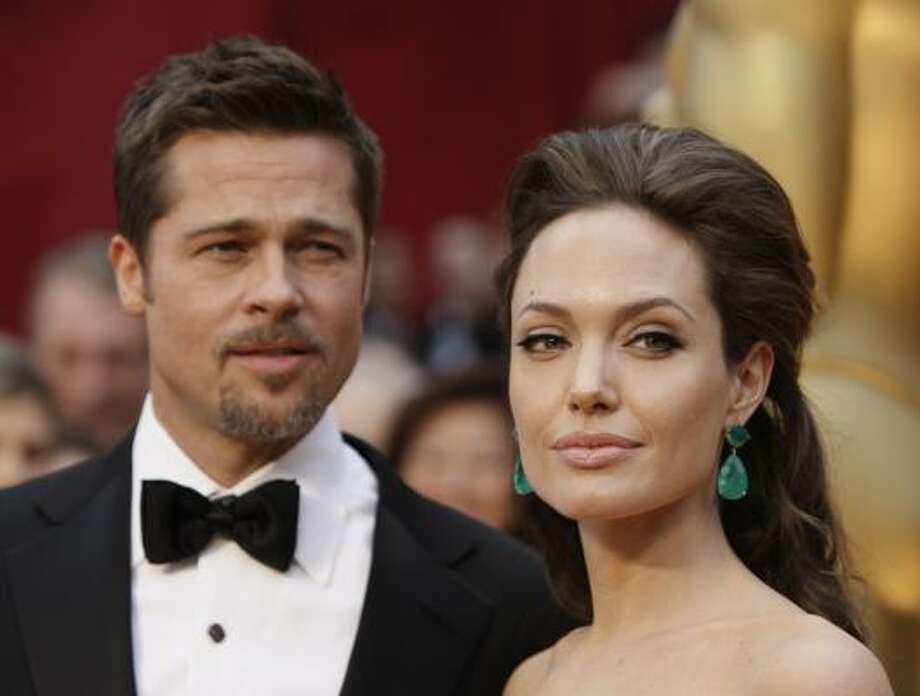 Angelina Jolie, and Brad Pitt Photo: Matt Sayles, AP