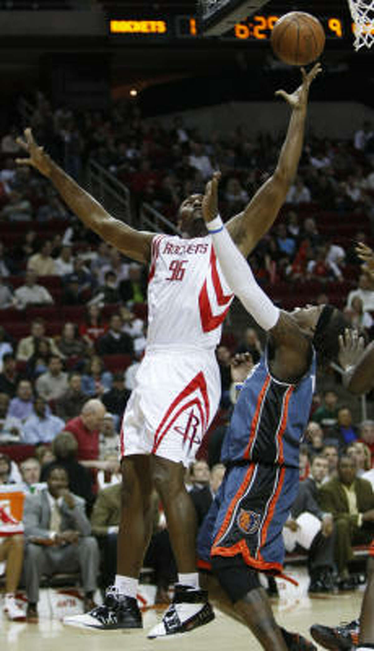Ron Artest (96) shoots over Bobcats forward Gerald Wallace in the first half. Artest scored a game-high 26 points to lead Houston.