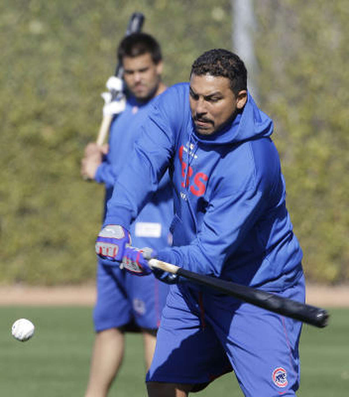 Chicago Cubs pitcher Carlos Zambrano practices his swing.