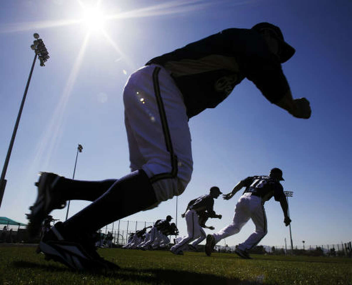 Milwaukee Brewers run a drill during spring training.