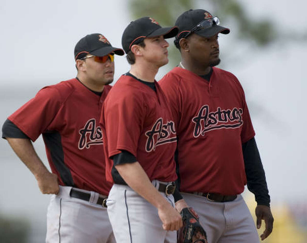 Jose Valverde (right) Tommy Manzella (center) and Felipe Paulino (left) stand at second base.