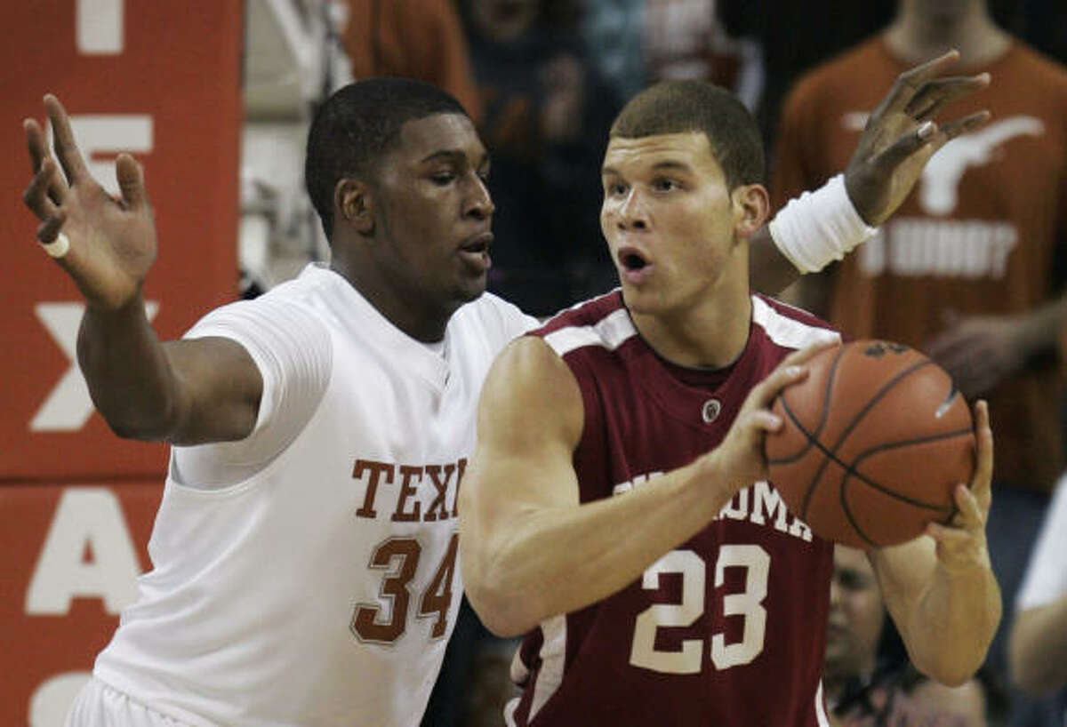 Texas 73, Oklahoma 68 Oklahoma forward Blake Griffin, right, looks to pass as Texas center Dexter Pittman defends during the first half.