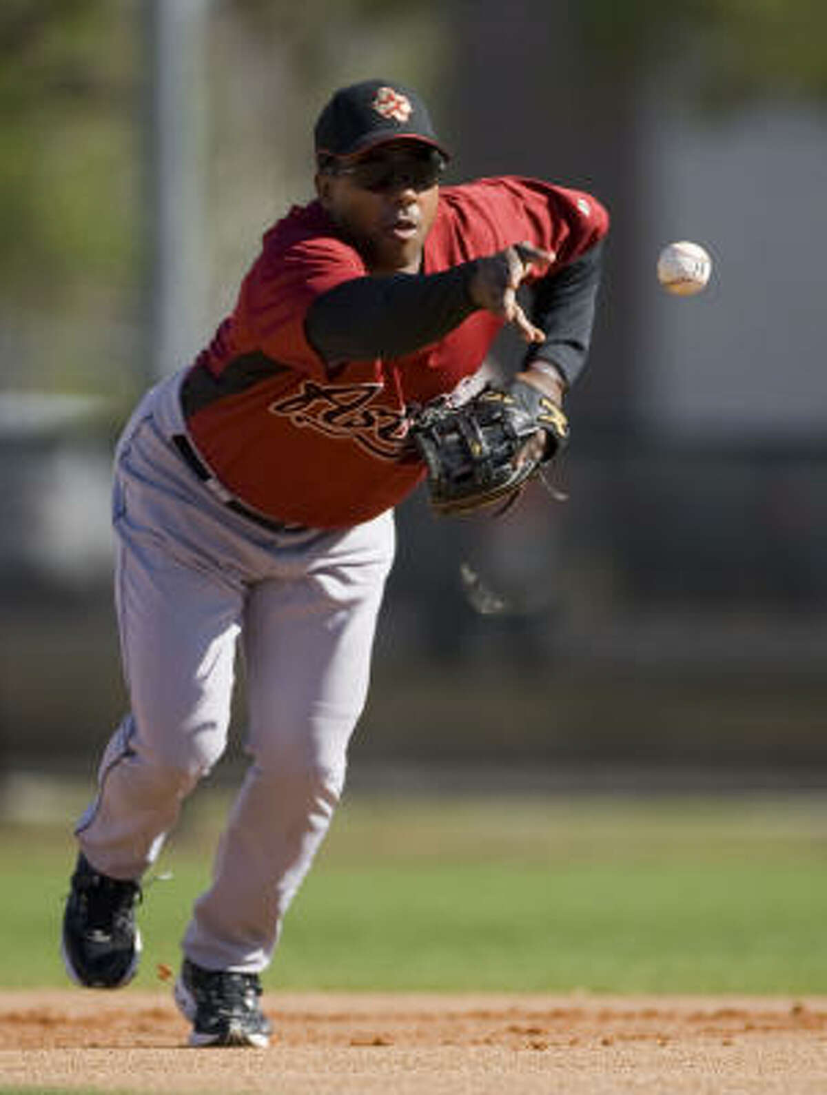 Miguel Tejada flips the ball during spring training Saturday.