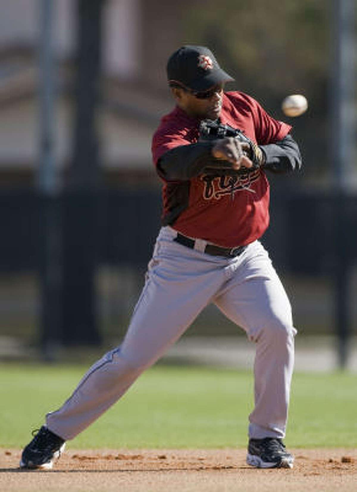 Miguel Tejada throws during a warmup.