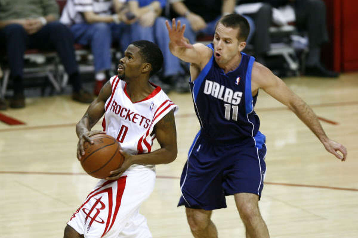 Aaron Brooks drives to the bucket as Mavericks guard Jose Juan Barea defends in the second quarter. Brooks made the start in place of recently traded Rafer Alston, who was sent to Orlando in three-team deal Thursday.