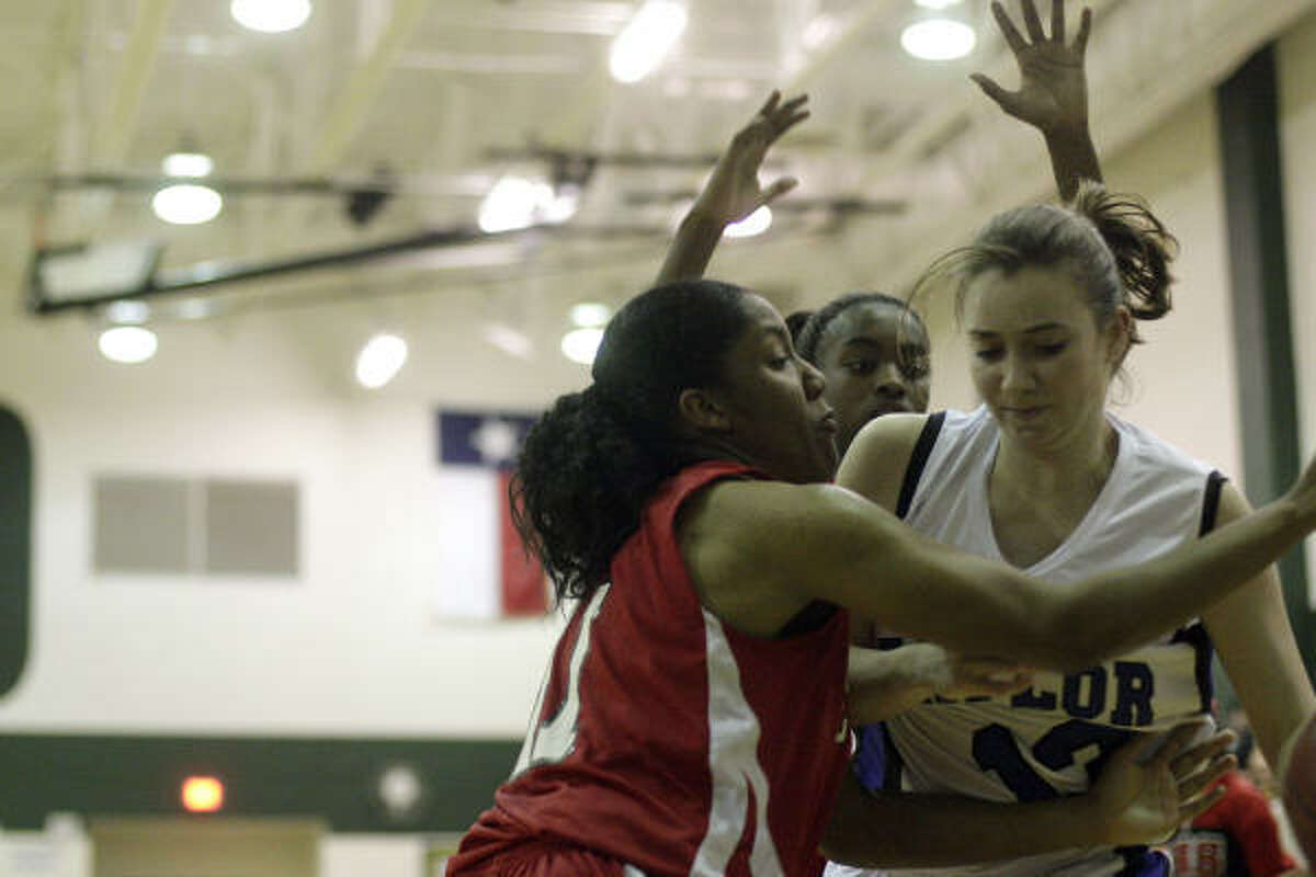 Katy Taylor junior Rachel Caldarera (13) is double teamed.