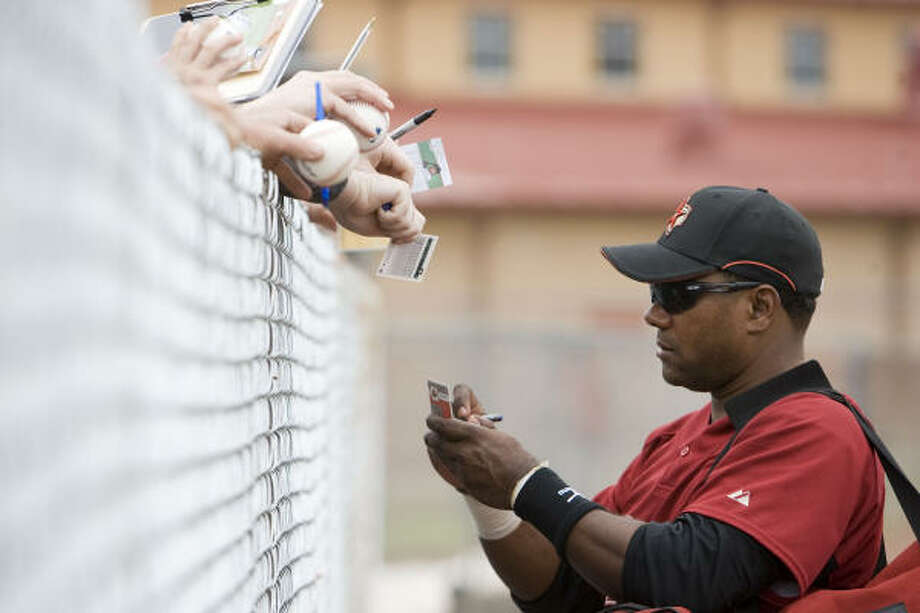 Miguel Tejada signs autgraphs for fans during the Houston Astros spring training at Osceola County Stadium. Photo: James Nielsen, Houston Chronicle
