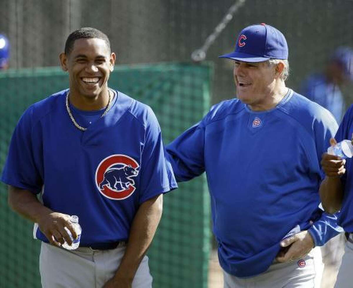 Chicago Cubs manager Lou Piniella, right, talks to Carlos Marmol, who is a candidate to be the Cubs closer.