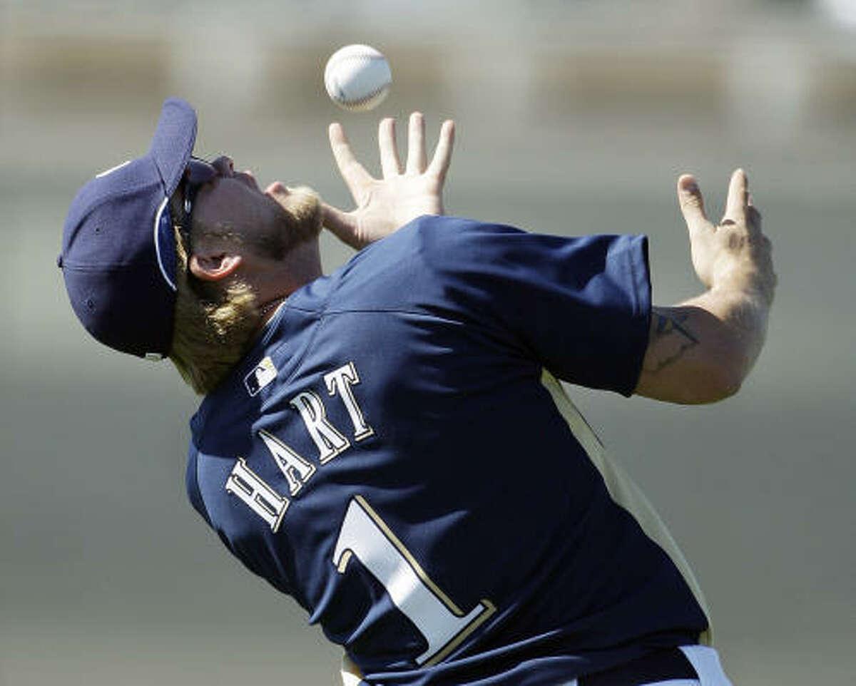 Milwaukee Brewers outfielder Corey Hart attempts to make a gloveless catch during a drill.