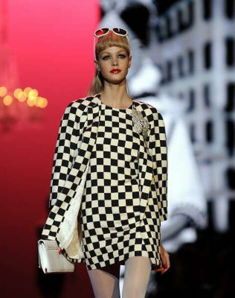 Nicole Miller went for a black and white checked mini with matching jacket.