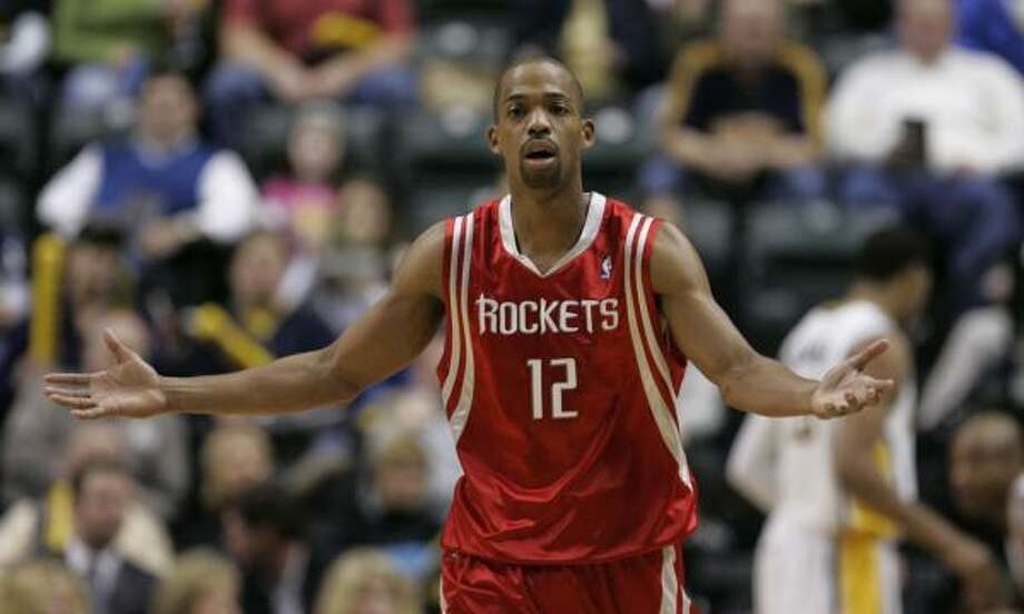 GOING:The Rockets traded point guard Rafer Alston to Orlando and received Magic forward Brian Cook and Memphis guard Kyle Lowry. Memphis received the Magic's first-round pick and center Adonal Foyle and guard Mike Wilks as part of the three-team deal. Photo: Darron Cummings, AP