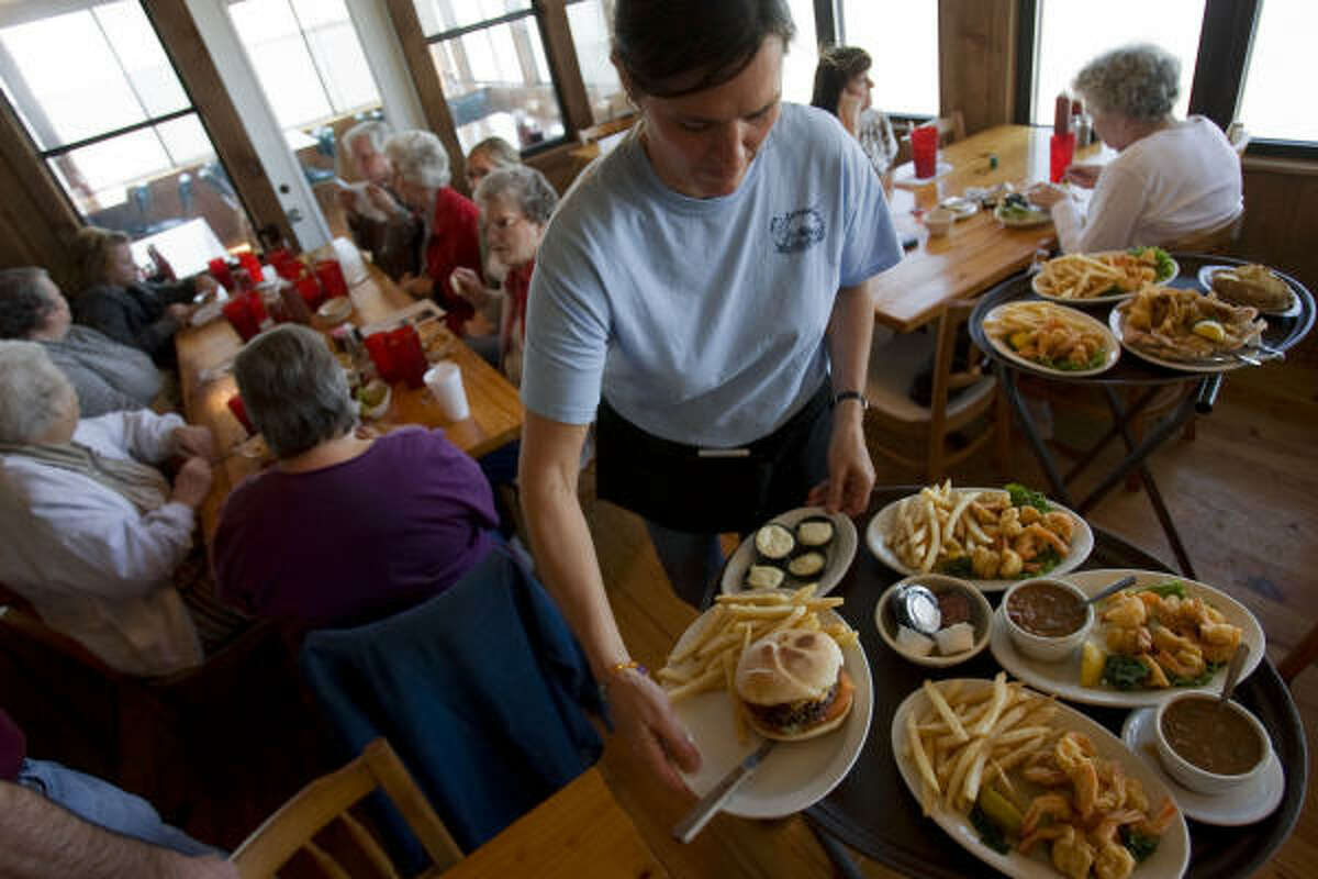 Waitress Marie Schulz serves lunch at Stingaree Restaurant, an iconic eatery on Crystal Beach, which is back open for business after Hurricane Ike.