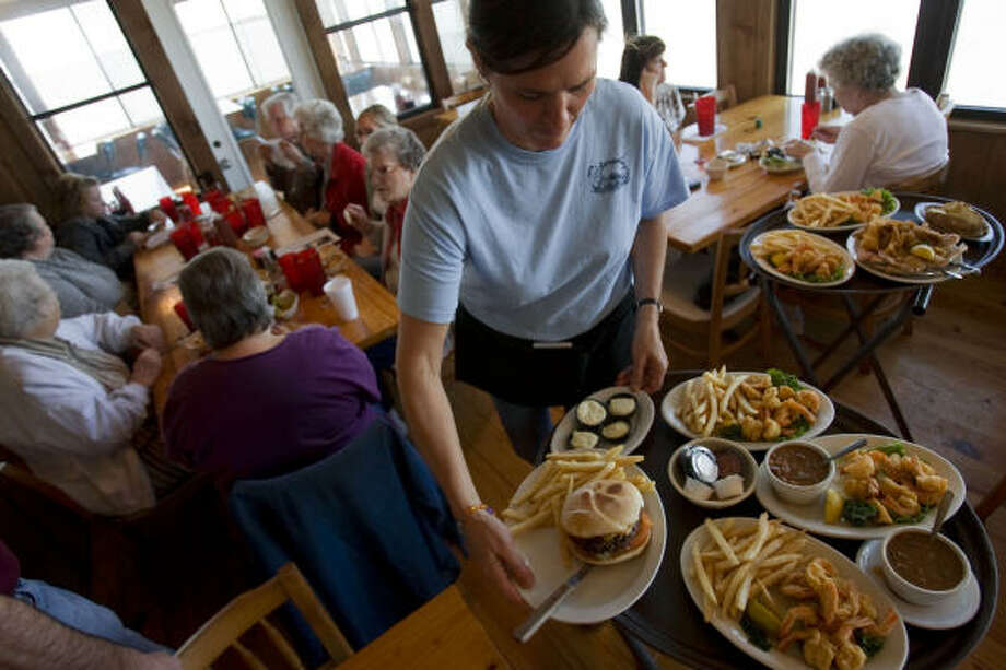 Waitress Marie Schulz serves lunch at Stingaree Restaurant, an iconic eatery on Crystal Beach, which is back open for business after Hurricane Ike. Photo: Sharon Steinmann, Chronicle