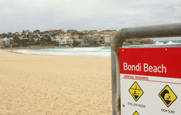 A general warning sign is seen Thursday at an empty Bondi Beach, which closed temporarily after a shark attack the previous day. Photo: Mark Kolbe, Getty Images