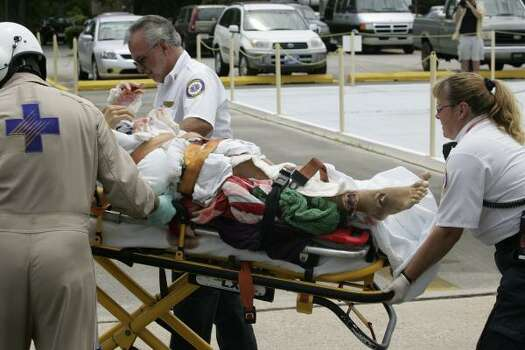 A teenage boy who was critically injured along Florida's northwestern coast is taken from a medical helicopter in Panama City, Fla., in 2005. The boy was attacked off Cape San Blas, a popular vacation destination. Photo: TERRY BARNER, AP